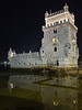 Belem Tower with a reflection at night. Sometimes called the Tower of St. Vincent, this was the starting point for many voyages of discovery starting in 1515. It was built as a fortress to guard Lisbon's harbor and is a symbol of Portugal as well as a UNESCO World Heritage monument.