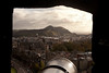 A vista of Arthur's Seat and the city of Edinburgh through one of the cannon gunports in Edinburgh Castle. Arthur's Seat is an extinct volcano that overlooks the city.