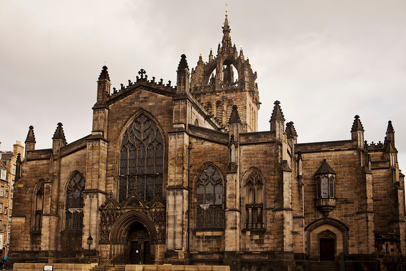 The front stone facade and main tower of the St. Giles Cathedral in Edinburgh, Scotland. The historic landmark is in the middle of the Royal Mile in the center of the city.