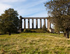 This partially completed replica of the Parthenon is known as the Scottish National Monument. Located on Calton Hill near the center of Edinburgh in Scotland, this structure is unfinished due to lack of funds.