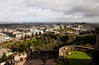 A view of the city of Edinburgh, Scotland as seen from above in a panorama view from the vantage point of Edinburgh Castle.