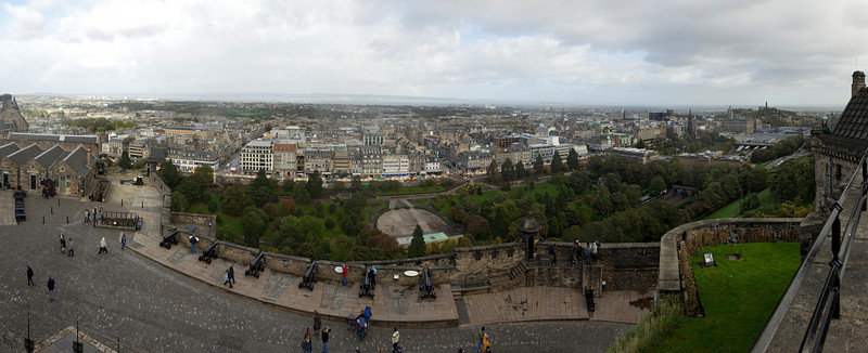 A panoramic view of the city looking out over the ramparts and walls of Edinburgh Castle.