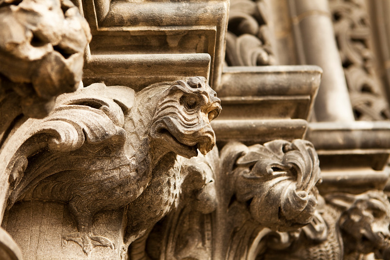 A steries of dragon gargoyles carved in stone line the main entrance door to St. Giles Cathedral in Edinburgh, Scotland.