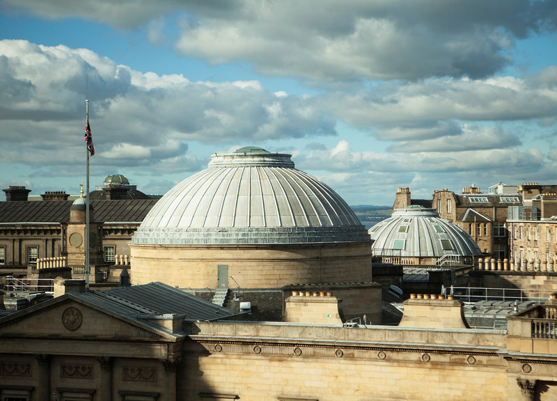 A dramatic view, just before sunset, of the rooftops of the New Town area of Edinburgh. The copper domes are part of one of the museums in the city.