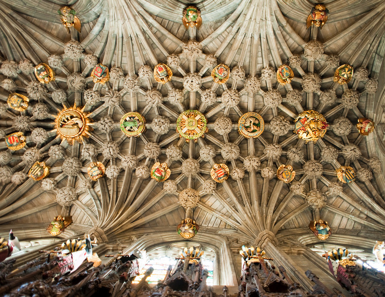 A view of the ceiling of the Thistle Chapel in St. Giles Cathedral in Edinburgh, Scotland. This ornately decorated ceiling has a number of symbols representing a variety of religious and spiritual concepts.