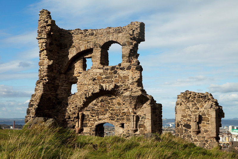 The medieval ruins of St. Anthony's chapel in Holyrood Park overlooking the city of Edinburgh.