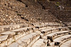 Rows of marble stone seats rise up in the ancient Greek theater at Ephesus in Turkey. There are two theaters in Ephesus and this is the small theatre.