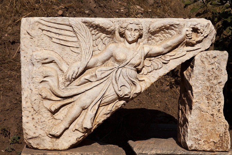A fragment of an ancient Greek or Roman stone frieze seen in Ephesus (near Izmir, Turkey) shows the figure of a female Amazon warrior as indicated by the bandaging over the left breast.