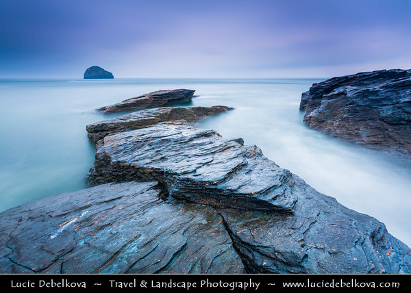 Europe - UK - England - Cornwall - North Cornwall - Trebarwith Strand - Trebervedh Sian - The Strand - Vast cliffs, dark caves, fine golden sand and Gull rock, almost reminiscent of a dogs head emerging from Atlantic Ocean during moody evening