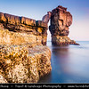 "Europe - UK - England - Dorset - Jurassic Coast - Isle of Portland - Pulpit Rock - Sea stack of Pulpit Rock is all that remains of a large natural arch, ""White Hole"" which was removed by quarrymen who cut and loaded the stone insitu onto waiting barges"