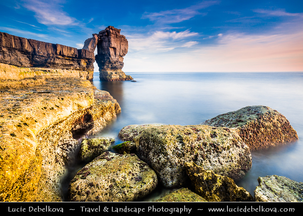 """Europe - UK - England - Dorset - Jurassic Coast - Isle of Portland - Pulpit Rock - Sea stack of Pulpit Rock is all that remains of a large natural arch, """"White Hole"""" which was removed by quarrymen who cut and loaded the stone insitu onto waiting barges"""