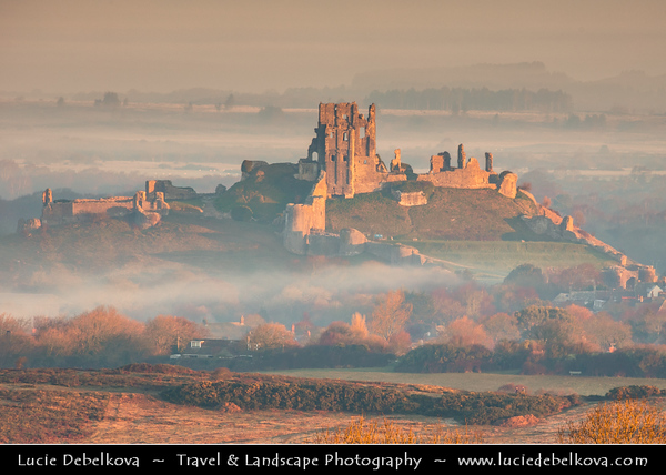 Europe - UK - United Kingdom - England - Dorset - Corfe Castle - One of Britain's most iconic locations - Dramatic ruins of Corfe Castle stand on a natural hill guarding principal route through Purbeck Hills
