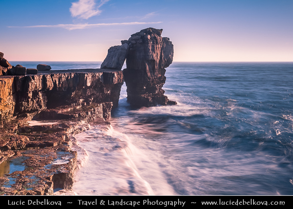 """Europe - UK - United Kingdom - England - Dorset - Jurassic Coast - Isle of Portland - Pulpit Rock - Coastal feature located at promontory Portland Bill - Sea stack of Pulpit Rock - Remainer of large natural arch, """"White Hole"""" which was removed by quarrymen"""