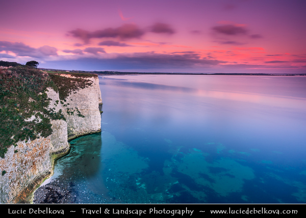 Europe - UK - United Kingdom - England - Dorset - Jurassic Coast - UNESCO World Heritage Site - Old Harry Rocks - Iconic natural white limestone cliffs with three chalk formations, including stack & stump at Handfast Point on Isle of Purbeck at Sunrise