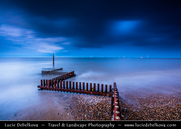 Europe - UK - England - East Anglia - Norfolk - Great Yarmouth - Coastal town at mouth of River Yare - Caister-on-sea long sandy beach on shores of North Sea with Zig Zag wave breaker poles during stormy evening