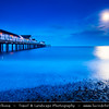 Europe - UK - England - East Anglia - Suffolk - Southwold - Southwold Pier - Pleasure Pier at northern edge of town, extending 190 metres (620 ft) into North Sea during Dusk, Twilight, Blue Hour, Night with Full Moon