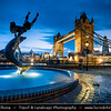Europe - UK - United Kingdom - England - London - Tower Bridge & Dolphin Fountain on banks of the River Thames at Dusk - Twilight - Blue Hour - Night