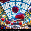 Europe - UK - England - London - Covent Garden - Popular tourist location containing cafes, pubs, small shops & craft market called the Apple - Christmas Decorations - Giant red Xmas baubles, sparkling silver glitter balls & more than 150,000 lights