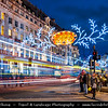 Europe - UK - England - London - Regent Street Christmas Lights with the theme of the twelve days of Xmas - Home to a number of big retail stores including its famous resident Liberty of London - Famous for its Christmas illuminations
