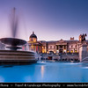 Europe - UK - United Kingdom - England - London - National Gallery at Trafalgar Square - Iconic square's lit fountains with artworks and statues -  Dusk - Twilight - Blue Hour - Night