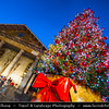 Europe - UK - England - London - Covent Garden - Popular tourist location containing cafes, pubs, small shops & craft market called the Apple - Christmas Decorations - St Paul's Church, commonly known as the Actors' Church & Large Christmas Tree