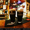 UK - Northern Ireland - County Derry - Londonderry - Old walled city on the west bank of the River Foyle - Traditional Irish bar with music and dark Guinness beer at night