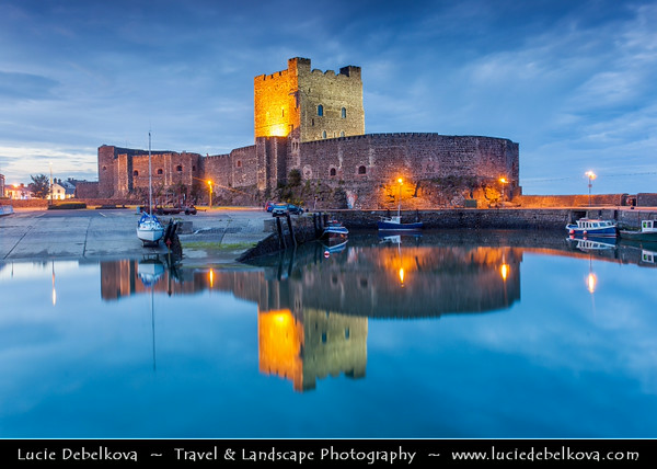 UK - Northern Ireland - County Antrim - Carrickfergus - Carrickfergus Castle - Norman castle in Northern Ireland, situated on the shore of Belfast Lough - Dusk - Twilight - Blue Hour - Night