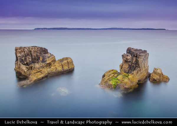 Europe - UK - Northern Ireland - County Antrim - Ballycastle - Pan's Rock formation at the eastern end of Ballycastle Beach viewed from the rock formation called The Devils Churn