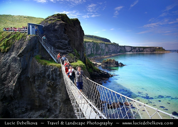 Europe - UK - Northern Ireland - County Antrim - Causeway Coastal Route - Rated as one of the Top Five Road Trips worldwide with ever changing tapestry of scenery and colours, set against a dramatic coastal backdrop - Famous Carrick-a-Rede Rope Bridge - Traditionally fishermen erected the bridge to Carrick-a-Rede island over a 23m-deep and 20m-wide chasm to check their salmon nets