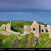 Europe - UK - Northern Ireland - County Antrim - Dunluce Castle - Dún Libhse - Spectacular ruined medieval castle positioned on the edge of a basalt outcropping with extremely steep drops into the sea on either side, accessible via a bridge connecting it to the mainland