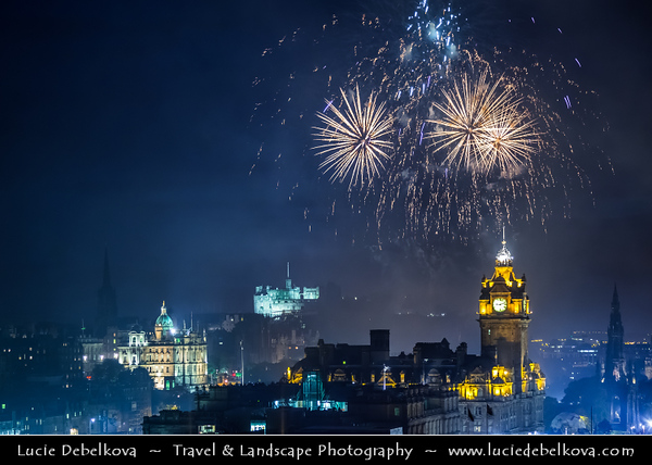 Europe - UK - United Kingdom - Scotland - Edinburgh - Dùn Èideann - Capital city of Scotland & Seat of Scottish Parliament - City View from Calton Hill featuring the impressive Balmoral Hotel Clock Tower with Spectacular firework above the historical center