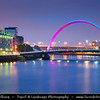 Europe - UK - United Kingdom - Scotland - Glasgow - Glesga - Clyde Arc bridge - Squinty bridge spanning over river Clyde - New landmark bridge at Dusk - Twilight - Blue Hour