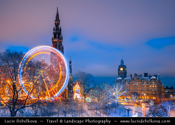 Europe - UK - Scotland - Edinburgh - Dun Eideann - Capital city of Scotland & Seat of Scottish Parliament - Christmas Wheel & The Scott Monument in Princes Street Gardens - Winter scene under heavy snow cover - Dusk - Twilight - Blue Hour - Night
