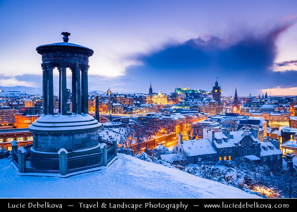 Europe - UK - Scotland - Edinburgh - Dùn Èideann - Capital city of Scotland & Seat of Scottish Parliament - City View from Calton Hill with Dugald Stewart Monument in foreground - Winter scene under heavy snow cover