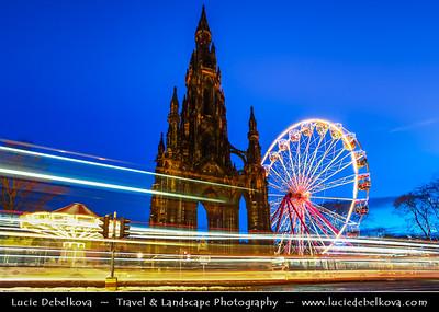 Europe - UK - Scotland - Edinburgh - Dun Eideann - Capital city of Scotland & Seat of Scottish Parliament - Christmas Wheel & The Scott Monument in Princes Street Gardens - Winter scene under heavy snow cover - Dusk - Twilight - Blue Hour - Night
