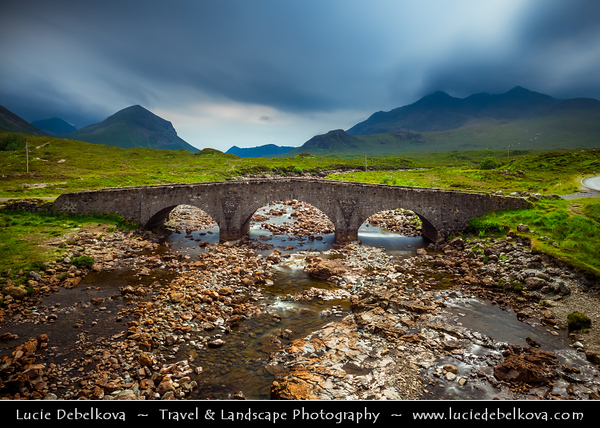 Europe - UK - United Kingdom - Scotland - Inner Hebrides - Isle of Skye - Glen Sligachan - Sligeachan - Skye crossroad with great views over Cuillin mountains - Traditional historical arched bridge