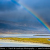 Europe - UK - Scotland - Western Isles of Scotland - Outer Hebrides - Isle Harris - Stunning white beaches of the north of the island captured during dramatic weather - Rainbow