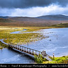 Europe - UK - United Kingdom - Scotland - Western Scottish Highlands - Landscape around Loch Gowan - Freshwater loch in Wester Ross - Dramatic changeable weather - Wooden footbridge over the lake