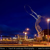 Europe - UK - Northern Ireland - Belfast - Béal Feirste - Capital of NI along river Lagan - Central Cityscape along waterfront - Beacon of Hope Sculpture next to Queens Bridge at Dusk - Twilight - Blue Hour