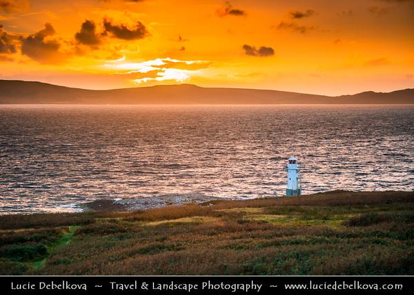 Europe - UK - United Kingdom - Scotland - Western Scottish Highlands - Ross and Cromarty - Rhue Lighthouse vantage point looking up Loch Broom - Dramatic Sunset