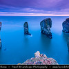 Europe - UK - Wales - South West Wales - Pembrokeshire Coast National Park - Bosherston - Elegug Stacks at St. Govan's Head - Spectacular Rocks which has been carved by the sea - One of the most iconing places on the beautiful & remote Pembrokeshire cost at Dusk - Twilight - Blue Hour - Night
