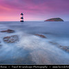 Europe - UK - Wales - North West Wales - North-eastern tip of Isle of Anglesey - Penmon Lighthouse & Puffin Island at the north entrance to the Menai Strait, marking the passage between the two islands  - Sunset - Dusk