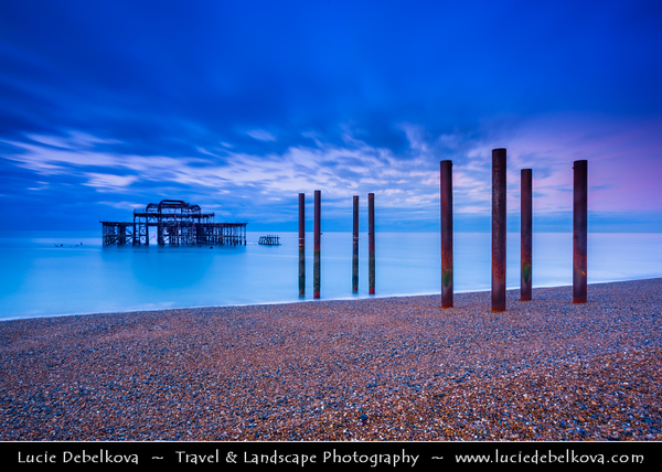 Europe - UK - United Kingdom - England - Sussex - Brighton - One of first of great seaside resorts of Europe - Old West Pier at Seafront at Dawn - Twilight - Blue Hour