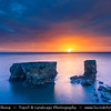 Europe - UK - United Kingdom - England - Northumberland - North East of England - Lizard Point - Limestone sea stack at Whitburn on the South Tyneside coastline at dramatic sunrise