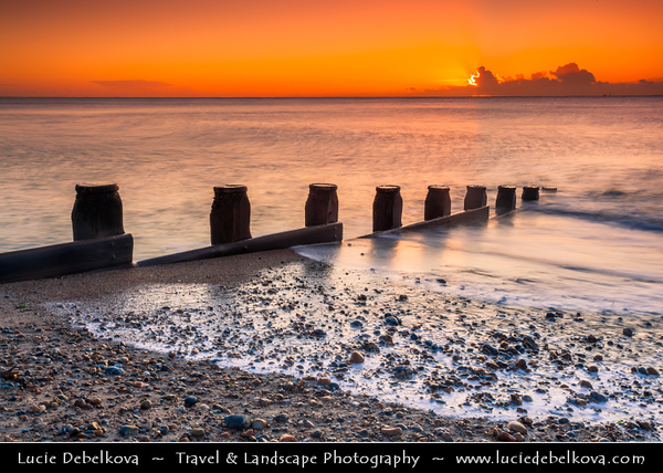 Europe - UK - United Kingdom - England - Sussex - Eastbourne - Popular seaside resorts - Beach with wooden wave breakers at Sunrise