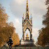 A cyclist riding past the Albert Memorial inside Hyde Park in London.