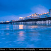 Europe - UK - England - Sussex - Brighton - One of the first of the great seaside resorts of Europe - Brighton Marine Palace and Pier on city seafront at Dusk - Dawn - Twilight - Blue Hour