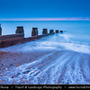 Europe - UK - United Kingdom - England - Sussex - Eastbourne - Popular seaside resorts - Beach with wooden wave breakers at Dusk - Dawn - Night - Twilight - Blue Hour