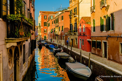 Venetian Canal Reflections with a Gondola and colourful houses