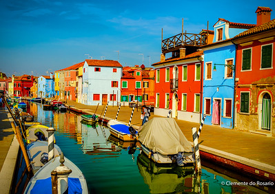 Canal lined with colourful houses in  Burano, Italy